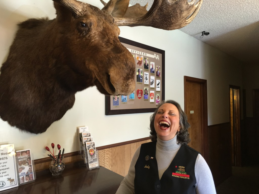 Judy shares a laugh with a moose